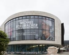 """Michael Schumacher - der Rekordweltmeister. 20 Jahre Partnerschaft mit der Deutschen Vermögensberatung"""" Marburg an der Lahn"""